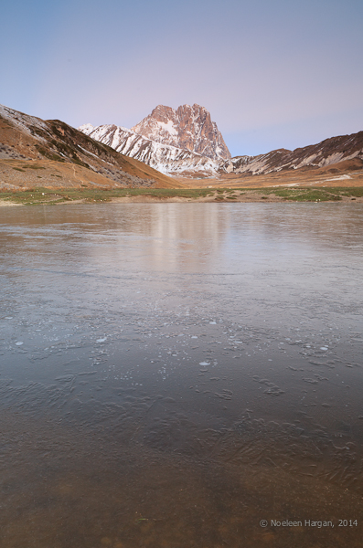 Icy lake and the Corno Grande in the distance