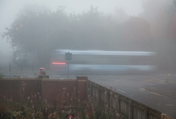 first bus in the morning mist